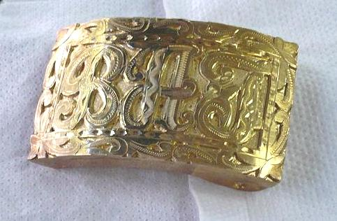"This is the ""all gold"" style of buckle popularized by the Westindians in Panama."