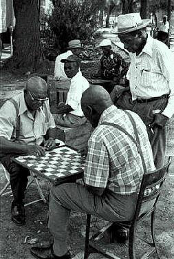 Oldtimers at an intense game of checkers.