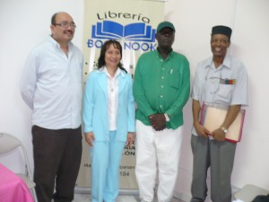 At the Book Nook in Colon. Left to right, Dr. Wong Vega, Prof. Rita Wong Lew, Lic. Winston Churchill James, and Prof. Roberto Reid Green.