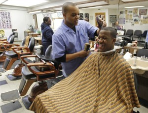 "Of course, this is a modern image of a black barbershop in the U.S. but, notice the planks in the background barber seats- ""The Kiddie Chairs.""  Image"