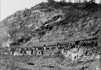 Contractor's Hill about 1910.  The breaking down of this massive piece of solid rock was a tremendous and dangerous undertaking and the black, West Indian Silvermen met the challenge.  The image is thanks to the Library of Congress.